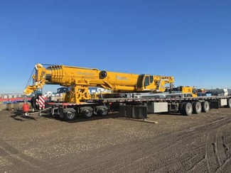 Picture of 2 yellow mobile crane rentals in the RB Oilfield Grande Prairie yard.